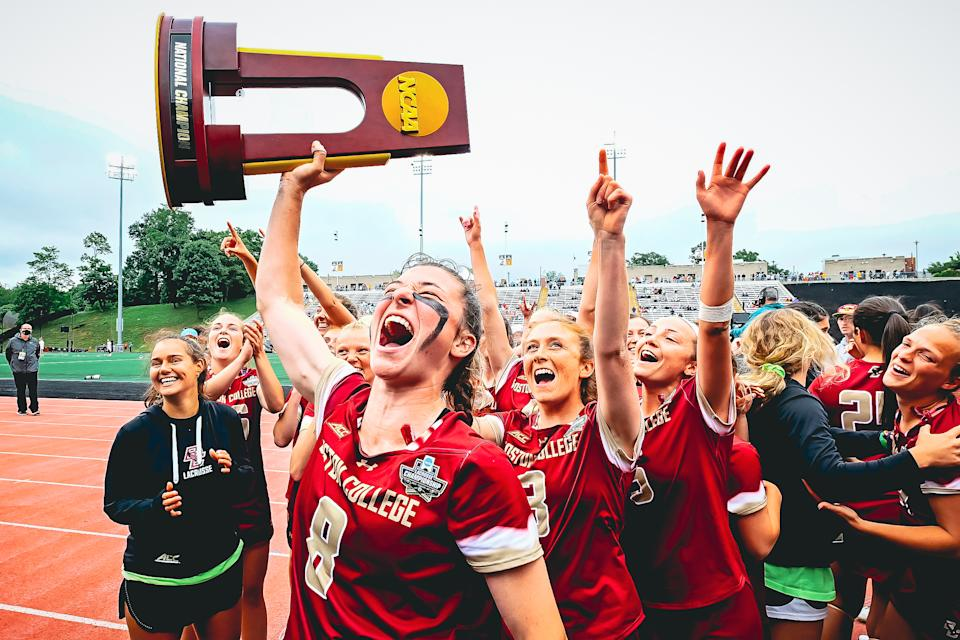 Boston College lacrosse star Charlotte North celebrates with an NCAA trophy after the Eagles' championship. (Credit: BC athletics)