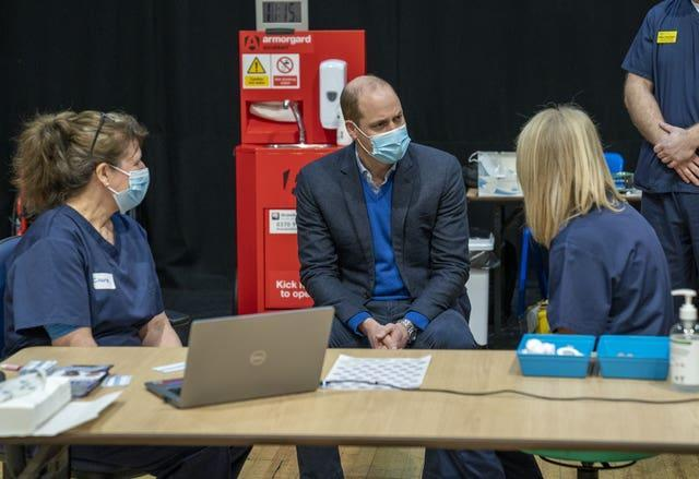 The Duke of Cambridge speaks to staff during his visit to the King's Lynn Corn Exchange