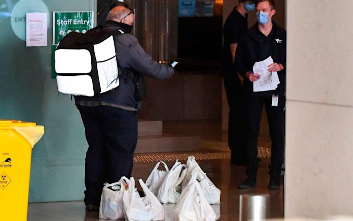 Food parcels being delivered to the hotel in Melbourne where players are currently quarantining - William West/AFP