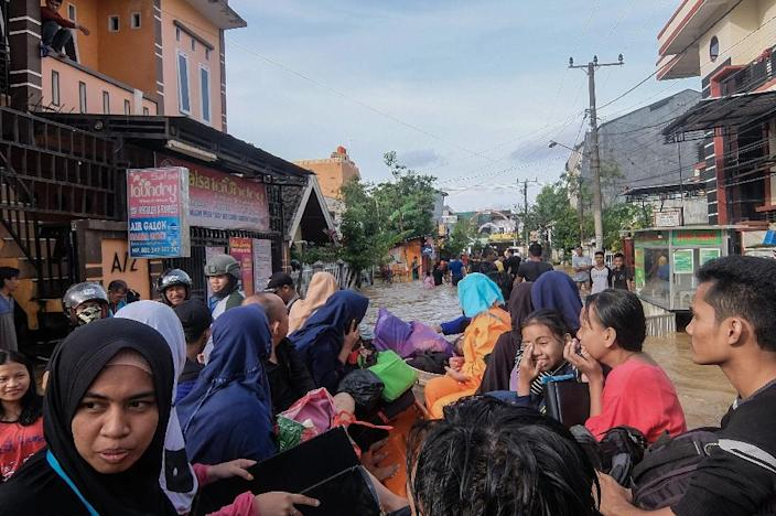 Indonesia's disaster agency said flooding in South Sulawesi province was receding but evacuations were continuing (AFP Photo/STR)