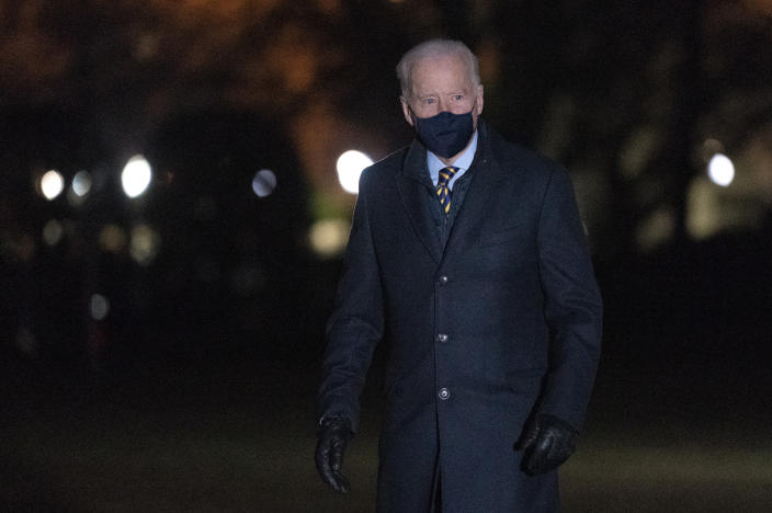 President Joe Biden walks on the South Lawn of the White House after stepping off Marine One, Wednesday, Feb. 17, 2021, in Washington. Biden was returning to Washington after participating in a town hall event in Wisconsin. (AP Photo/Patrick Semansky)
