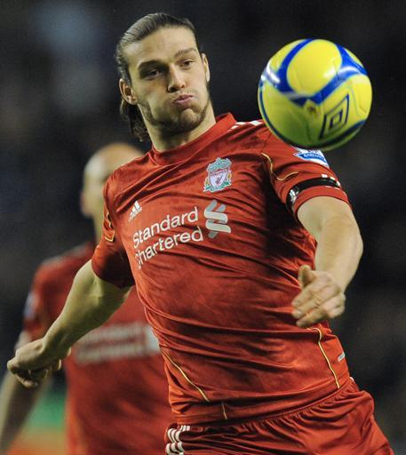 "Liverpool's English forward Andy Carroll eyes the ball during the FA Cup football match between Liverpool and Oldham Athletic at Anfield in Liverpool, north-west England, on January 6, 2012. Liverpool won 5-1.  AFP PHOTO/ ANDREW YATES RESTRICTED TO EDITORIAL USE. No use with unauthorized audio, video, data, fixture lists, club/league logos or ""live"" services. Online in-match use limited to 45 images, no video emulation. No use in betting, games or single club/league/player publications"