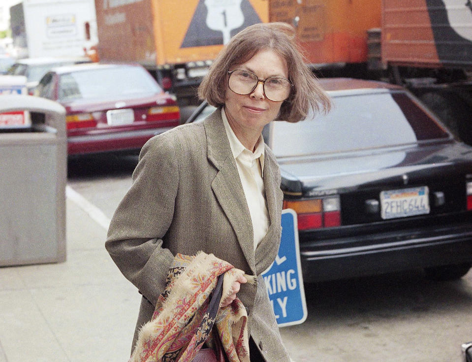 FILE - The New Yorker writer Janet Malcolm leaves the Federal Courthouse in San Francisco on June 3, 1993 in the suit trial brought by psychoanalyst Jeffrey Masson, who claims he was misquoted and libeled in a 1983 magazine article. Malcolm, the inquisitive and boldly subjective author and reporter known for her challenging critiques of everything from murder cases and art to journalism itself, has died. She was 86. Malcolm's death was confirmed Thursday by a spokesperson for The New Yorker, where Malcolm was a longtime staff writer. (AP Photo/George Nikitin, File)