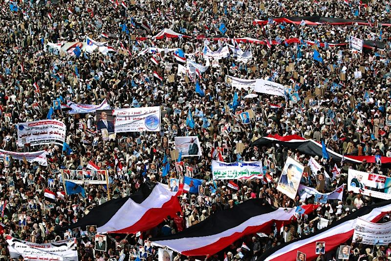 Yemenis protest against a Saudi-led coalition which supports various factions aligned with Yemen's internationally recognised government against Huthi rebels (AFP Photo/MOHAMMED HUWAIS)