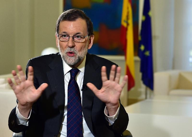 Rajoy promised to strive for a rapprochement with Catalonian government when he took power again in November, to solve what he has dubbed Spain's most serious problem (AFP Photo/Gerard JULIEN)