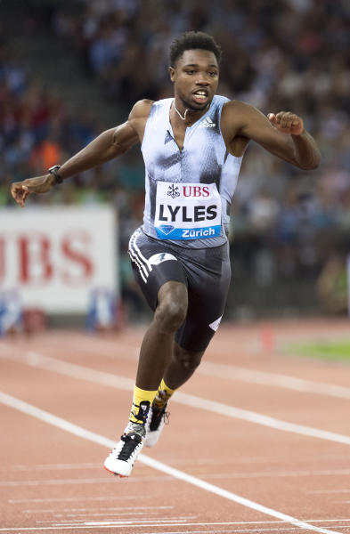 FILE - In this Aug. 29, 2019, file photo, Noah Lyles, of the United States, competes in the men's 100m race during the Weltklasse IAAF Diamond League international athletics meet in Zurich, Switzerland. The most promising signal that track and field remains in good hands even after Usain Bolts retirement comes from a 22-year-old American named Noah Lyles who appreciates the Jamaican superstar more for what he did after his races than during them. When Lyles spends time studying Bolt on video, he looks not at the lanky speedsters form in between the lines, but at the dancing, rollicking post-race celebrations Bolt concocted to make his sport cant-miss viewing whenever he was on the track. (Jean-Christophe Bott/Keystone via AP, File)