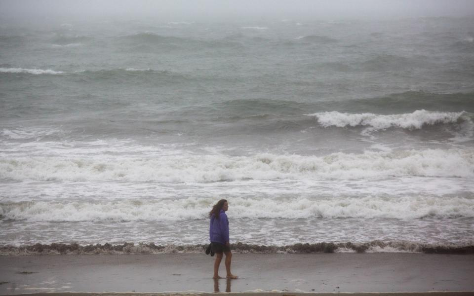 Meanwhile the sea at Looe, Cornwall, looks less than inviting for a summer holiday dip - SWNS