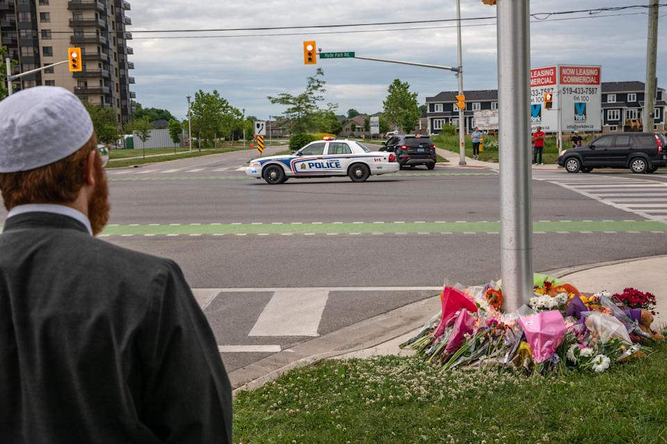 <p>A police car passes the location where a family of five was hit by a driver, in London, Ont., Monday, June 7, 2021. Four of the members of the family died and one is in critical condition. A 20 year old male has been charged with four counts of first degree murder and count of attempted murder in connection with the crime. THE CANADIAN PRESS/Brett Gundlock</p>