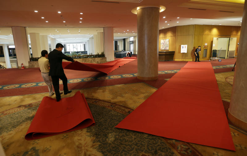 South Korean workers roll up red carpets to remove them from the venue for the Koreas' first high-level meeting at Grand Hilton Hotel in Seoul, South Korea, Wednesday, June 12, 2013. The Koreas' first high-level talks in years were scrapped a day before they were to begin Wednesday because the sides didn't agree on the delegation leaders, South Korea said. The cancellation deflated tentative hopes that the rivals would improve ties following years of rising hostility. (AP Photo/Lee Jin-man)
