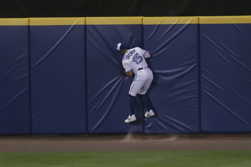 Toronto Blue Jays' Randal Grichuk makes a catch against the wall to seal a 12-4 victory over the Tampa Bay Rays during the ninth inning of a baseball game, Friday, Aug. 14, 2020, in Buffalo, N.Y. (AP Photo/Jeffrey T. Barnes)