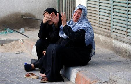 Relatives of Palestinian Othman Helles 15 who was killed at the Israel Gaza border react in Gaza City