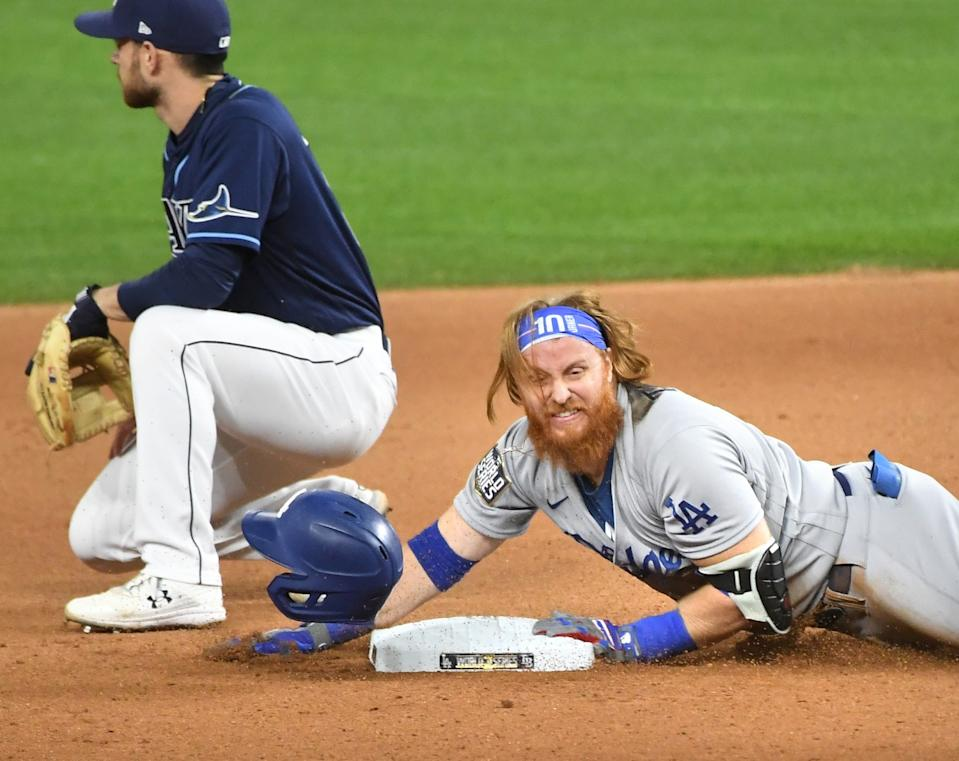 Dodgers Justin Turner slides safely for a double against the Rays in the 7th inning.