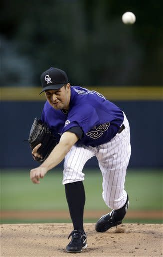 Colorado Rockies starting pitcher Jeff Francis delivers a pitch during the first inning of a baseball game against the Colorado Rockies in Denver on Monday, Aug. 27, 2012. (AP Photo/Joe Mahoney)