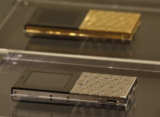 Mobile phones plated in stainless steel and 18-carat gold (top), with a price tag of HK$79,750 ($10,249) and HK$462,000 ($59,380) respectively, are shown at a luxury goods department store in Hong Kong October 20, 2011.