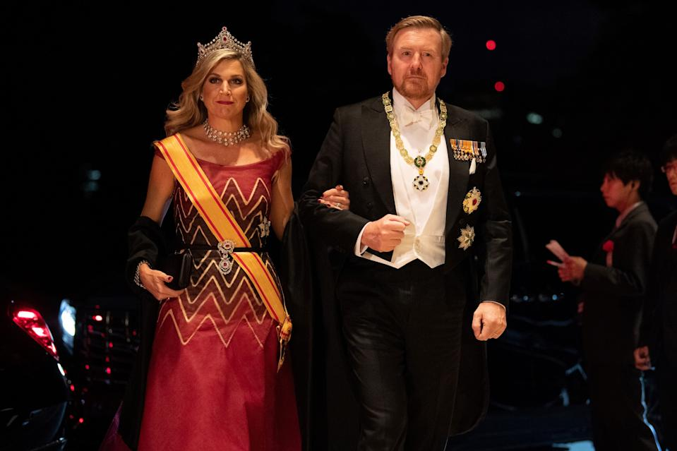 Netherlands' King Willem-Alexander and his wife Queen Maxima arrive at the Imperial Palace for the court banquet in Tokyo on October 22, 2019. - Japan's Emperor Naruhito completed his ascension to the Chrysanthemum throne on October 22 in a ceremony steeped in the traditions and grandeur of a monarchy that claims 2,000 years of history. (Photo by Pierre Emmanuel DELETREE / POOL / AFP) (Photo by PIERRE EMMANUEL DELETREE/POOL/AFP via Getty Images)