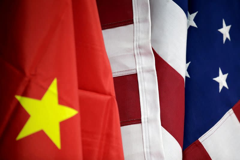 FILE PHOTO: Flags of U.S. and China are displayed at AICC's booth during China International Fair for Trade in Services in Beijing