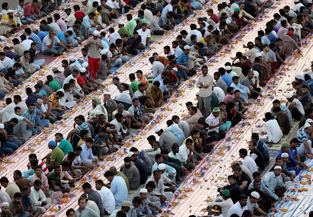 <p>Muslims break their fast with iftar during the holy month of Ramadan on May 29, 2017, in Dubai, United Arab Emirates. (Francois Nel/Getty Images) </p>