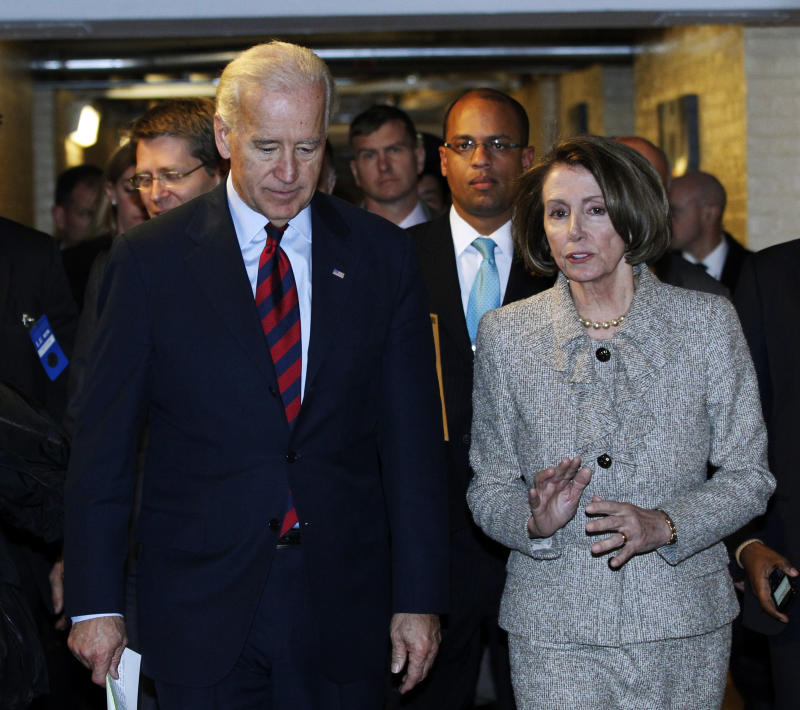 Vice President Joe Biden, left, and House Speaker Nancy Pelosi talk as they leave a Democratic Caucus meeting on Capitol Hill in Washington, Wednesday, Dec. 8, 2010. (AP Photo/Manuel Balce Ceneta)