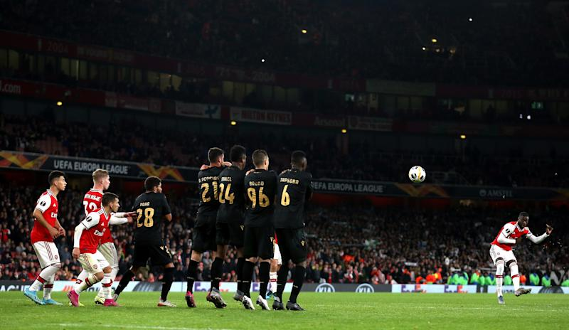 Arsenal's Nicolas Pepe (right) scores his side's third goal of the game during the UEFA Europa League group F match at the Emirates Stadium, London. (Photo by Nigel French/PA Images via Getty Images)