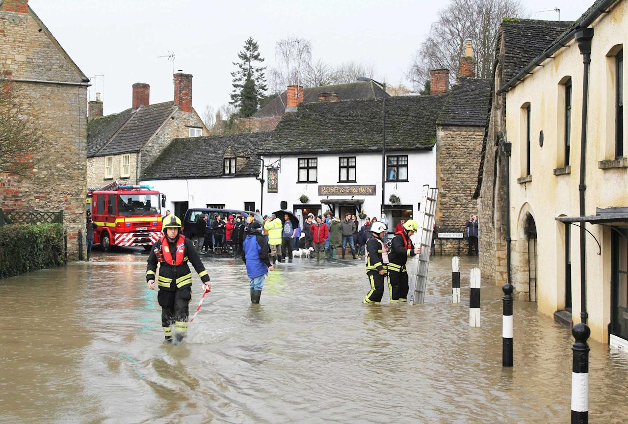 Flood scenes in Malmesbury, Wilts., where firefighters rescued three people trapped in the upper floors of a period home (SWNS)