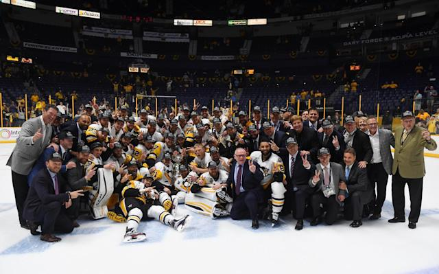 <p>Pittsburgh Penguins players and staff pose for a team photo after defeating the Nashville Predators in Game 6 of the 2017 Stanley Cup Final at Bridgestone Arena. Credit: Christopher Hanewinckel-USA TODAY Sports </p>