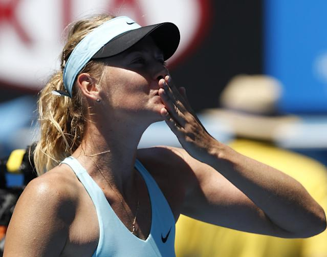 Maria Sharapova of Russia blows kisses to the crowd as she celebrates after defeating Karin Knapp of Italy in their second round match at the Australian Open tennis championship in Melbourne, Australia, Thursday, Jan. 16, 2014.(AP Photo/Eugene Hoshiko)