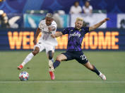 LA Galaxy defender Julian Araujo, left, battles for the ball with Seattle Sounders midfielder Kelyn Rowe during the first half of a Major League Soccer match Saturday, June 19, 2021, in Carson, Calif. (AP Photo/Mark J. Terrill)