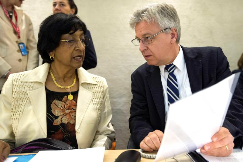 U.N. High Commissioner for Human Rights, South African Navanethem Pillay, left, speaks with, Polish Remigiusz Henczel, right, President of the Human Rights Council, prior during the 23rd session of the Human Rights Council, at the European headquarters of the United Nations in Geneva, Switzerland, Monday, May 27, 2013. The Unites States, Qatar and Turkey have asked the U.N.'s top human rights body to hold an urgent debate on the ways to end the civil war in Syria, and to hold accountable those responsible for killing thousands of civilians. Syria's Ambassador Faysal Khabbaz Hamoui objected to Monday's request, saying it comes from nations that support the rebels who have been battling the regime of Syria's President Bashar Assad since March 2011. U.N. Human Rights Council President Remigiusz Henczel says the council will decide Tuesday whether to hold the debate Wednesday. (AP Photo/Keystone,Salvatore Di Nolfi)