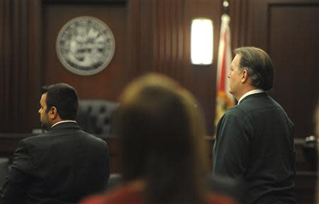 Michael Dunn (R), who faces first-degree murder charges in the death of 17-year-old Jordan Davis, stands with his attorney Cory Strolla (L) at Duval County Courthouse in Jacksonville, Florida February 6, 2014. REUTERS/Bob Mack/The Florida Times-Union/Handout