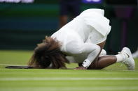 Serena Williams of the US falls to the ground during the women's singles first round match against Aliaksandra Sasnovich of Belarus on day two of the Wimbledon Tennis Championships in London, Tuesday June 29, 2021. (AP Photo/Kirsty Wigglesworth)
