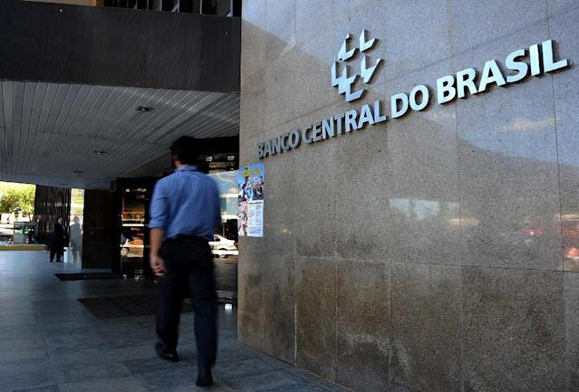 Bank's usual mandatory minimum of five hours opening will be reduced to four during the 2018 World Cup, Brazil's Central Bank said (AFP Photo/PEDRO LADEIRA)