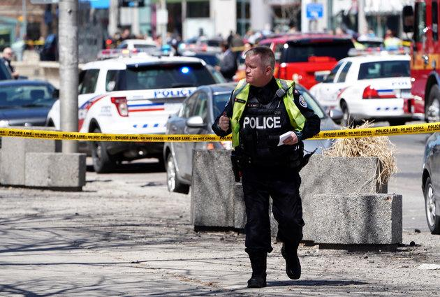 A police officer responds to the incident in the northern suburbs of Toronto.
