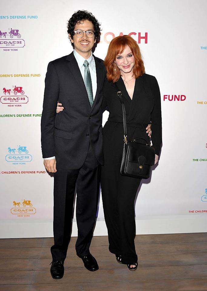 """Mad Men"" beauty Christina Hendricks went for a conservative look with her black Ralph Lauren suit, which she paired with a shoulder bag and shoes by Coach. Her best accessory? Her hubby Geoffrey Arend. John Shearer/<a href=""http://www.gettyimages.com/"" target=""new"">GettyImages.com</a> - April 20, 2011"