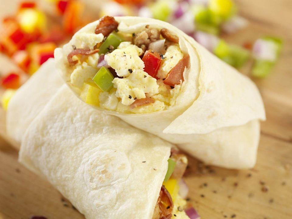 """<p>Breakfast is tricky, so having something on hand that's quick to prepare and easy to eat while you commute, apply mascara, or dial-in to a conference call is crucial. Look for frozen sandwiches made from real, whole food ingredients, like <a href=""""https://www.sweetearthfoods.com/our-products/#breakfast-burritos"""" rel=""""nofollow noopener"""" target=""""_blank"""" data-ylk=""""slk:Sweet Earth's Get Focused Breakfast Burrito"""" class=""""link rapid-noclick-resp"""">Sweet Earth's Get Focused Breakfast Burrito</a> or <a href=""""https://www.amys.com/our-foods/tofu-scramble-breakfast-wrap-gluten-free"""" rel=""""nofollow noopener"""" target=""""_blank"""" data-ylk=""""slk:Amy's Gluten Free Tofu Scramble Breakfast Wrap"""" class=""""link rapid-noclick-resp"""">Amy's Gluten Free Tofu Scramble Breakfast Wrap</a>. Aim for a minimum of 4 grams of protein and fiber a piece (the more, the better!) and try to cap sodium at less than 500 mg. Check labels for the good stuff: 100% whole grains, veggies, and eggs. They should contain least 300 calories a pop, and stay as low in saturated fat and added sugar as possible.</p>"""