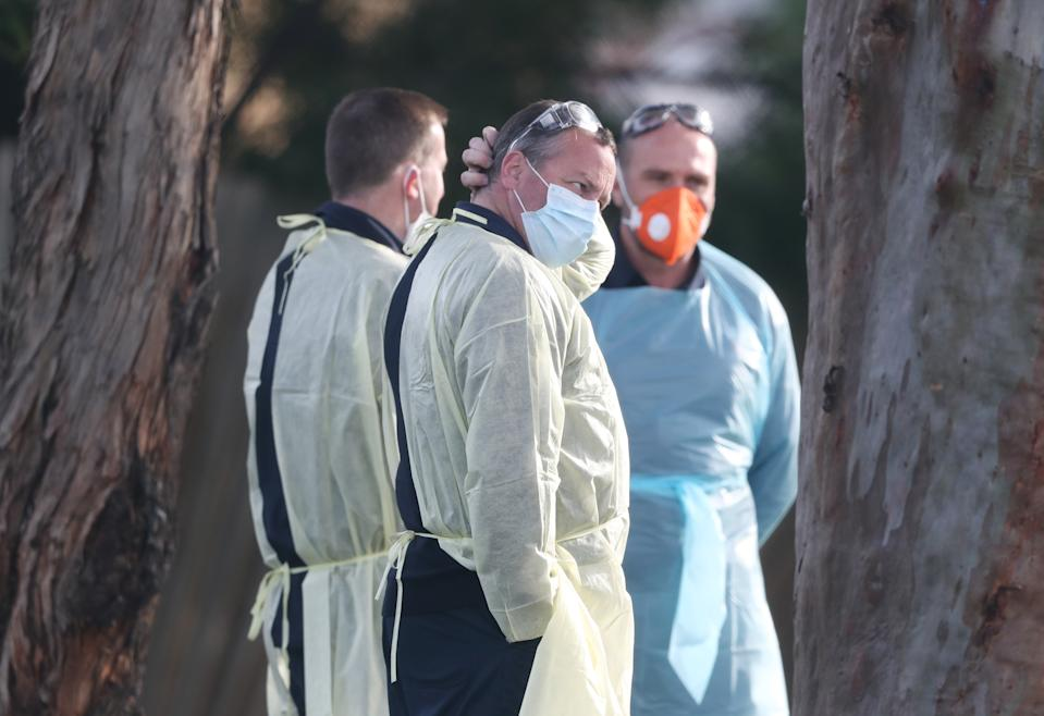 Medical staff waiting to transport residents at St Basils aged care facility to hospital. Source: AAP