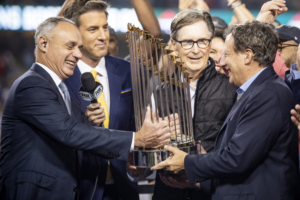 LOS ANGELES, CA - OCTOBER 28: Major League Baseball Commissioner Rob Manfred presents the World Series trophy to Boston Red Sox Principal Owner John Henry, Chairman Tom Werner, and President & CEO Sam Kennedy after winning the 2018 World Series in game five against the Los Angeles Dodgers on October 28, 2018 at Dodger Stadium in Los Angeles, California. (Photo by Billie Weiss/Boston Red Sox/Getty Images)