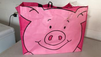 A pink M&S Percy Pig bag is pictured.