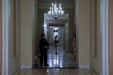 Capitol Police officer stands shortly after beginning the Government shutdown on Capitol Hill in Washington, U.S., January 20, 2018. REUTERS/Yuri Gripas