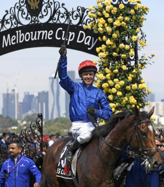 Cross Counter with jockey Kerrin McEvoy on board returns to the mounting yard after winning the Melbourne Cup at Flemington Racecourse in Melbourne, Australia, Tuesday, Nov. 6, 2018. (AP Photo/Andy Brownbill)