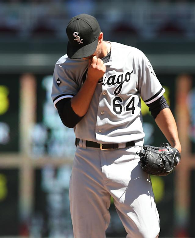 Chicago White Sox pitcher Andre Rienzo wipes his face after walking Minnesota Twins' Chris Parmelee in the fourth inning of a baseball game, Saturday, June 21, 2014, in Minneapolis. (AP Photo/Jim Mone)