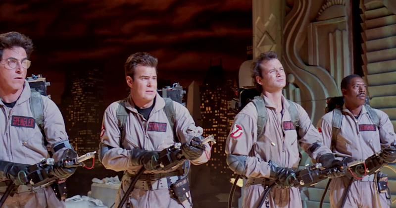 movie still from ghostbusters with bill murray, harold ramis and dan aykroyd in gray suits looking up