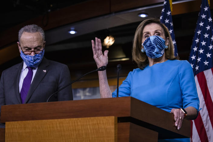 House Speaker Nancy Pelosi speaks alongside Senate Minority Leader Chuck Schumer during a joint press conference on Capitol Hill Thursday. (Photo by Samuel Corum/Getty Images)