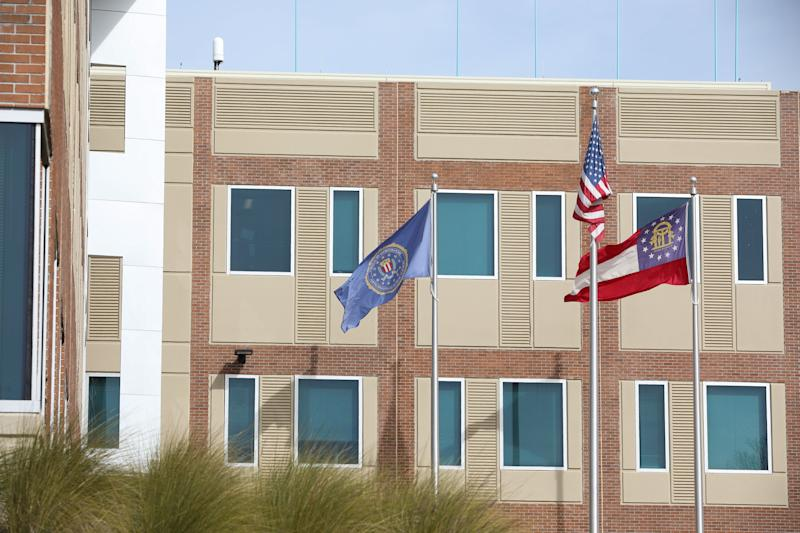 ATLANTA, GA - FEBRUARY 01: The FBI, American, and Georgia state flag fly outside the Atlanta Federal Bureau of Investigation field office on February 1, 2019 in Atlanta, Georgia. Federal, state and local law enforcement and other agencies work together in the Intelligence Operations Center (IOC) and Critical Response Joint Operations Center (CRJOC) in preparation of Super Bowl LIII. The FBI is working to mitigate threats that may arise at Superbowl LIII. (Photo by Jessica McGowan/Getty Images)
