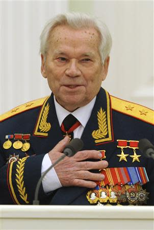 Mikhail Kalashnikov, the Russian inventor of the globally popular AK-47 assault rifle, gestures while meeting with Russia's President Dmitry Medvedev during festivities to celebrate his 90th birthday at the Kremlin in Moscow in this November 10, 2009 file photo. REUTERS/Natalia Kolesnikova/Files