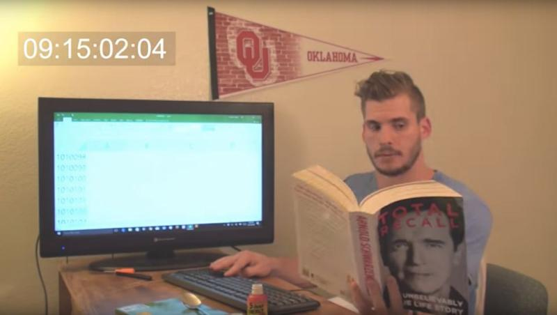 Mr Hobbs sits at his desk and passes the time by reading books, listening to music and talking on his mobile. Source: YouTube