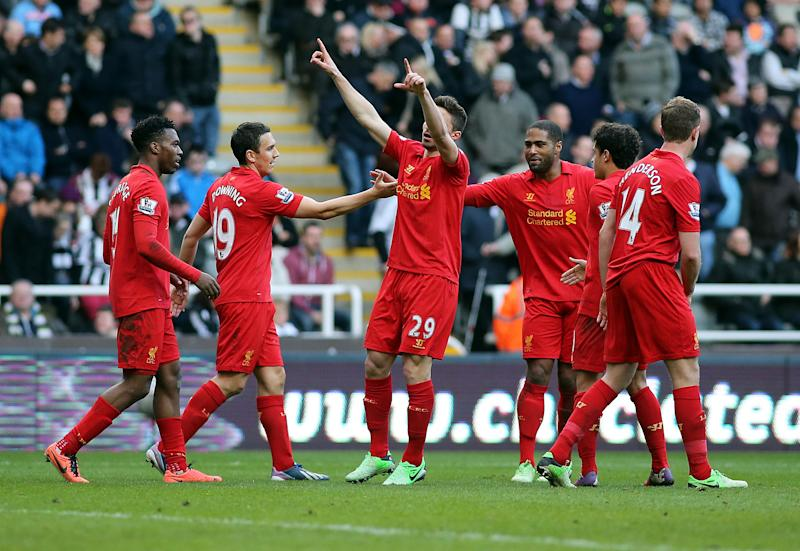 Liverpool's Fabio Borini, center, celebrates his goal with his teammates during their English Premier League soccer match against Newcastle United at St James' Park, Newcastle, England, Saturday, April 27, 2013. (AP Photo/Scott Heppell)