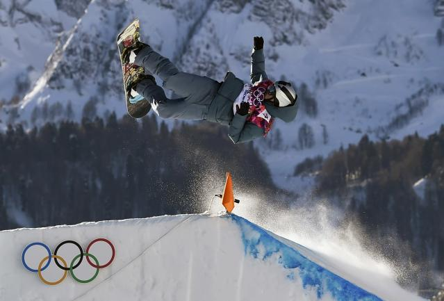 Russia's Alexey Sobolev performs a jump during the men's snowboard slopestyle semi-final competition at the 2014 Sochi Olympic Games in Rosa Khutor February 8, 2014. REUTERS/Dylan Martinez (RUSSIA - Tags: OLYMPICS SPORT SNOWBOARDING)
