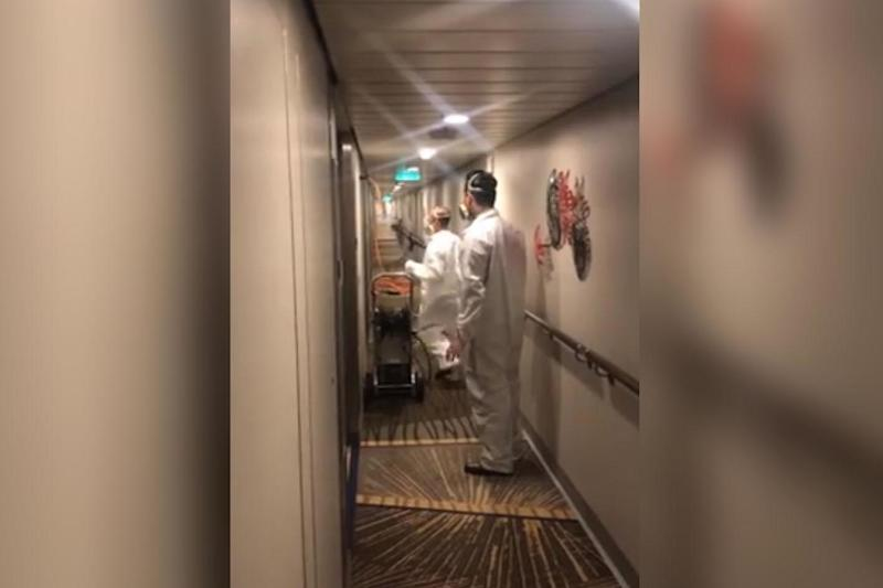 Crew members were filmed hosing down the hallways of the luxury liner on Monday: Facebook