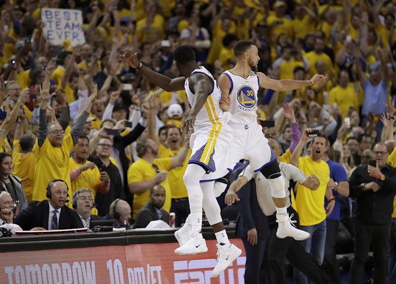 Draymond Green, Stephen Curry and the Warriors are the odds-on favorites to win next year's NBA title. (AP)