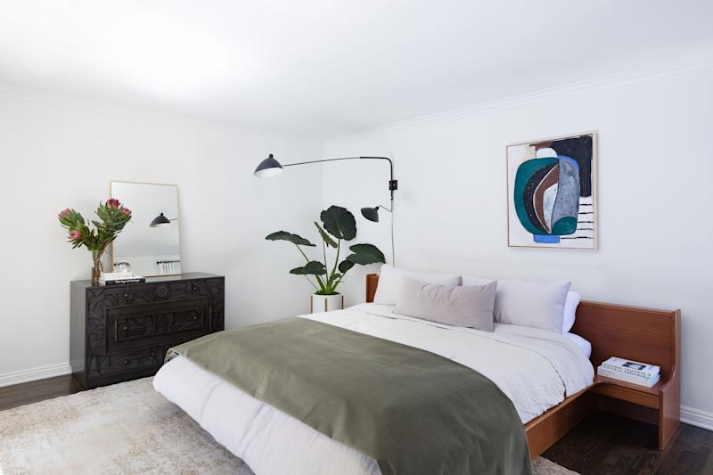 """Which is Georgia's favorite room? """"I would have to say my bedroom,"""" she answers. """"I love the bed frame I found at a market, the off-centered artwork, and obnoxiously large wall lamp."""""""
